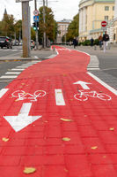 bike lane or red road with signs of bicycles