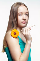 Teenager girl with flower lollipop in hands. Sweet tooth concept