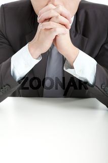 businessman in thinking  with hand on the office desk