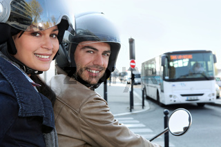 Couple on scooter at a crossroad
