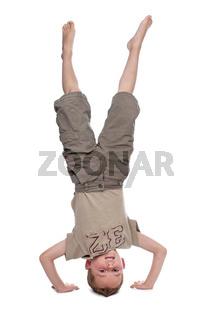 little boy standing on hands