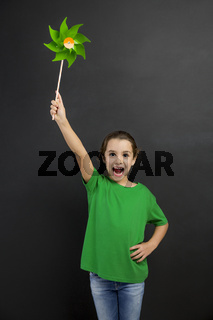 Little girl holding a windmill