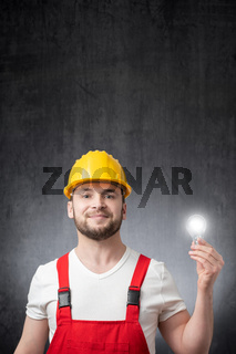Construction worker with a light bulb