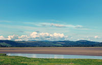 view of the river kent near arnside and sandside in cumbria with surrounding lakeland hills