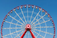 Ferris wheel on blue sky background.