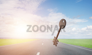 Conceptual background image of concrete key sign on asphalt road