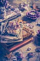 Memories - old family photo album with necklace, old books and dried flowers