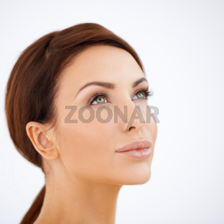 Beautiful serene woman daydreaming