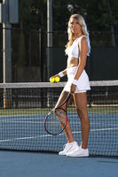 A Lovely Blonde Model Plays Tennis Outdoors In The Summer Sun