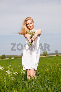 beautiful blonde woman outdoor in summer happy