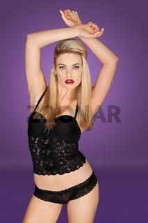Stunning blonde modeling sexy black lingerie