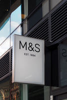 sign above a marks and spencer simply food store in leeds city centre
