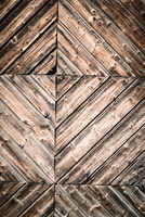 Geometric abstract closeup of natural aged and rural rustic wood surface of recycled weathered planks constructed in creative, decorative lines, old vintage wooden background or backdrop with space for text