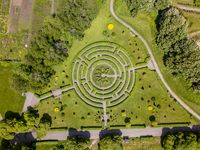 Aerial view of labyrinth, roads and trees at botanical garden
