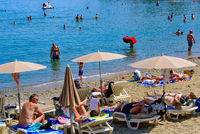 People having fun on the beach in summer in Collioure, France