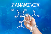 Hand with pen drawing the chemical formula of Zanamivir