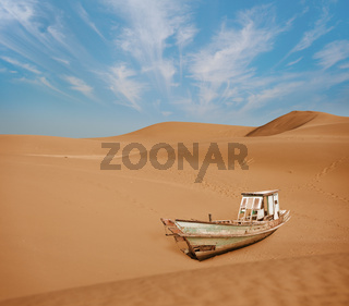 Old boat among the sand dunes in the desert