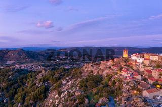 Drone aerial panorama view of Monsanto historic village at sunset, in Portugal