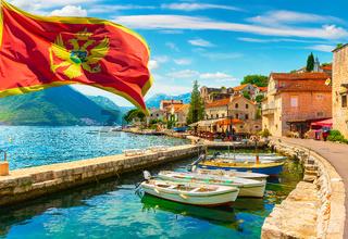 Flag and city Perast Montenegro