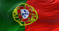 Detail of the national flag of Portugal flying in the wind.
