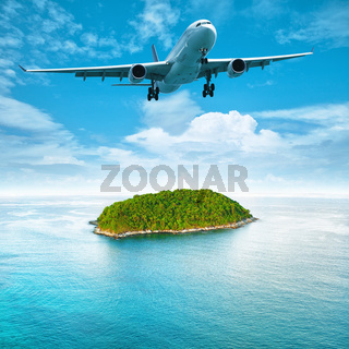 Jet aircraft over the tropical island. Square composition.