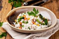 Bowl with tasty rice and vegetables