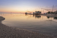 Panoramic view of fishing huts at sunrise near Ravenna