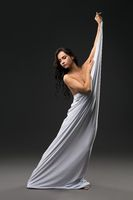 Graceful naked woman wrapped in white cloth