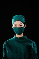 Portrait of a young female surgeon, bust