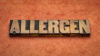 allergen word abstract in vintage letterpress wood type