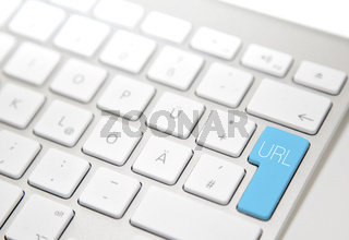 White computer keyboard with 'URL' button