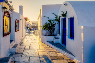 Oia village Santorini with blue domes and whitewashed house during sunset at the Island of Santorini Greece