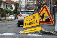 Road closed and diversion signs in French town