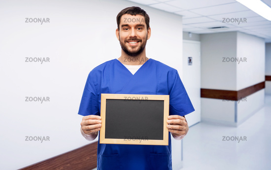 happy smiling male doctor or nurse with chalkboard