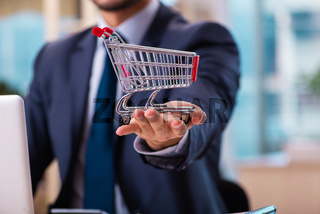 Young male employee in ecommerce concept