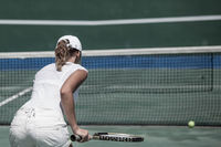 Woman playing tennis on court