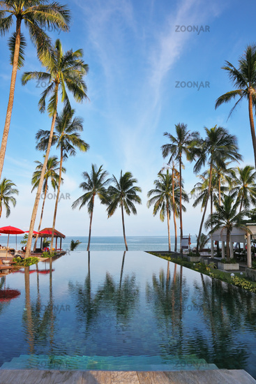 A Thai gulf, red umbrellas, plank beds and palm