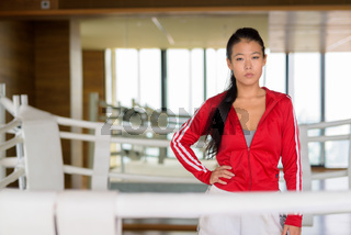Portrait of beautiful Asian woman ready for exercise at gym boxing ring