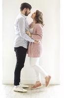 Tender couple hugging on white background