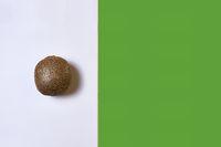 Kiwi on white and green soil
