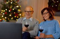 couple drinks wine and watches tv on christmas