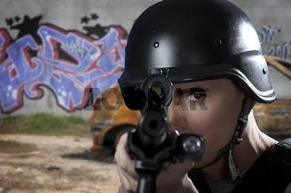 Police officer aiming a shotgun