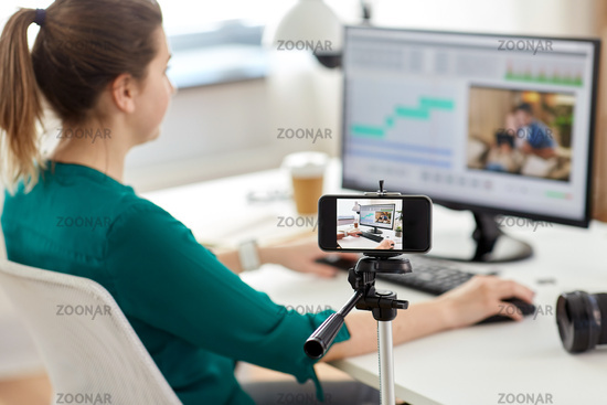 smartphone recording woman working in video editor