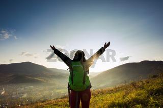 Greeting sun while long solo mountain trip