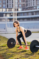 Strong woman exercising with barbell. Sports, fitness concept.