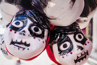 Plastic heads with skeleton face as decoration for Halloween sold at the market for 'day of the dead' at Merida, Mexico