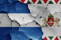 flags of District XX. (Pesterzsebet) and Budapest painted on cracked wall