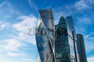 Skyscraper and cloudy blue sky background