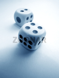 Square dice on color background