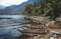 Small wooden canoes along the shore of lake Atitlan, Santiago Atitlan, Guatemala